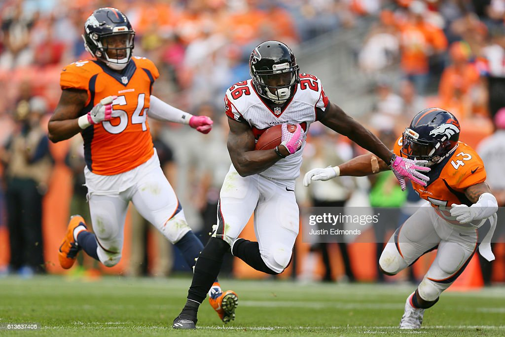 Running back Tevin Coleman #26 of the Atlanta Falcons catches a pass and runs for a touchdown in the third quarter of the game against the Denver Broncos at Sports Authority Field at Mile High on October 9, 2016 in Denver, Colorado.