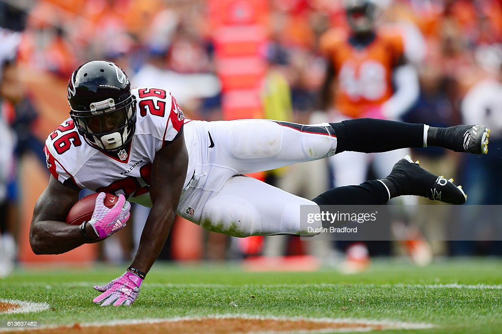 Running back Tevin Coleman #26 of the Atlanta Falcons dives for a touchdown in the third quarter of the game against the Denver Broncos at Sports Authority Field at Mile High on October 9, 2016 in Denver, Colorado.