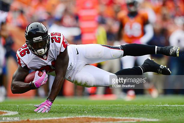 Running back Tevin Coleman of the Atlanta Falcons dives for a touchdown in the third quarter of the game against the Denver Broncos at Sports...