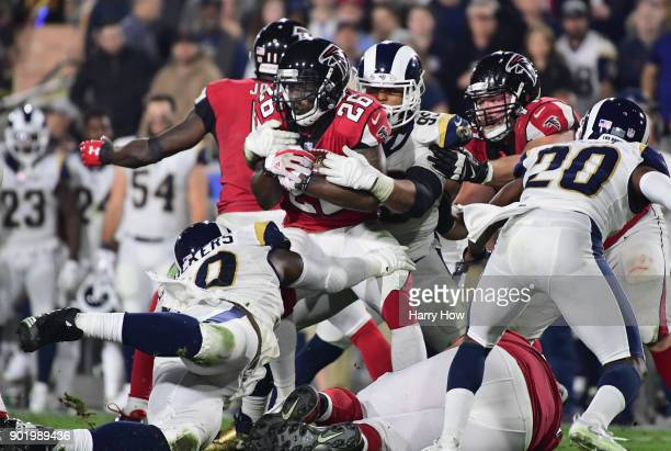 Running back Tevin Coleman of the Atlanta Falcons is tackled by defensive end Aaron Donald of the Los Angeles Rams during the second quarter of the...