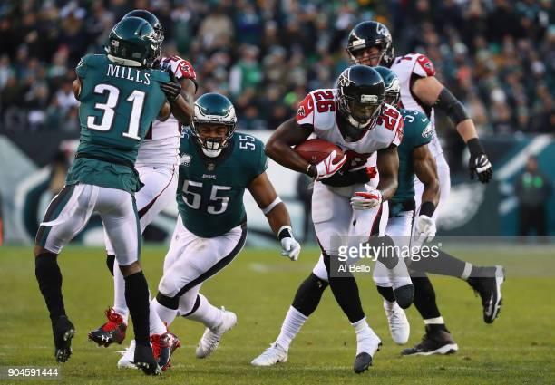 Running back Tevin Coleman of the Atlanta Falcons runs the ball against cornerback Jalen Mills and defensive end Brandon Graham of the Philadelphia...