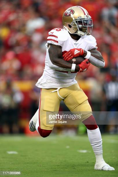Running back Tevin Coleman of the San Francisco 49ers in actin during the preseason game against the Kansas City Chiefs at Arrowhead Stadium on...