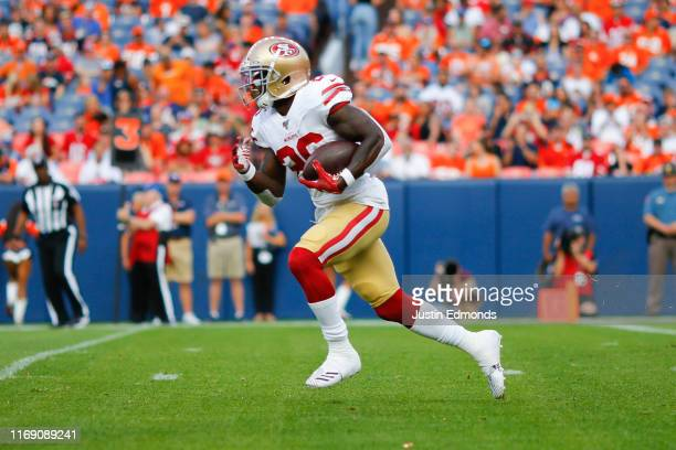 Running back Tevin Coleman of the San Francisco 49ers in action against the Denver Broncos during a preseason game at Broncos Stadium at Mile High on...