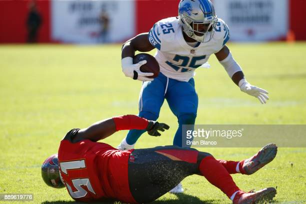 Running back Theo Riddick of the Detroit Lions avoids middle linebacker Kendell Beckwith of the Tampa Bay Buccaneers during a carry in the second...