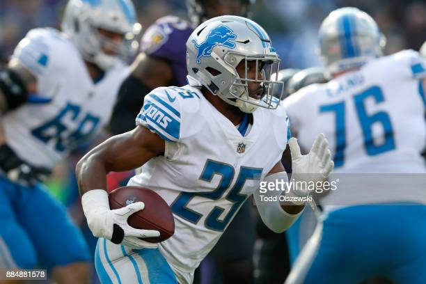 Running Back Theo Riddick of the Detroit Lions carries the ball in the first quarter against the Baltimore Ravens at MT Bank Stadium on December 3...