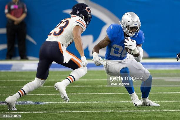 Running back Theo Riddick of the Detroit Lions runs with the ball past the defense of Kyle Fuller of the Chicago Bears during an NFL game at Ford...