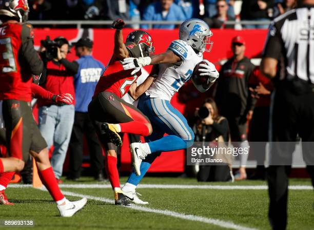 Running back Theo Riddick of the Detroit Lions slips a tackle by cornerback Brent Grimes of the Tampa Bay Buccaneers as he rushes for a 16yard...