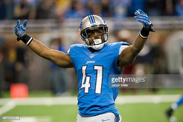 Running back Theo Riddick of the Detroit Lions tries to rev up the crown prior to kick off against the Baltimore Ravens during the first half at Ford...