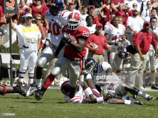 Running back Thomas Brown of the Georgia Bulldogs rushes for a 38yard touchdown against the Mississippi Rebels at Sanford Stadium on September 29...