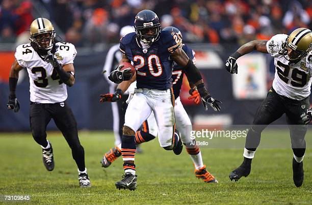 Running back Thomas Jones of the Chicago Bears runs for 33yards against Mike McKenzie and Josh Bullocks of the New Orleans Saints during the second...