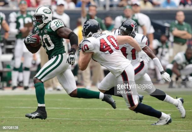 Running back Thomas Jones of the New York Jets eludes free safety John Busing of the Houston Texans as he scores on a 38 yard run in the fourth...