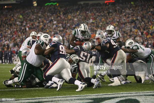 Running Back Thomas Jones of the New York Jets is stood up at the Goal Line by Linebacker Jerod Mayo of the New England Patriots on November 13 2008...
