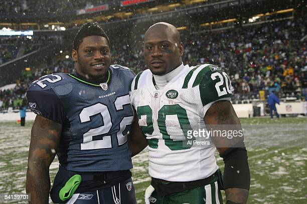 Running Back Thomas Jones of the New York Jets meets with his brotherRunning Back Julius Jones of the Seattle Seahawks on December 21 2008 when the...