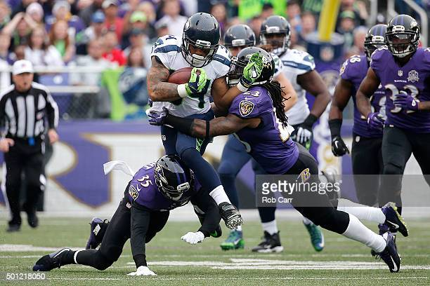 Running back Thomas Rawls of the Seattle Seahawks carries the ball against defensive back Shareece Wright of the Baltimore Ravens and free safety...