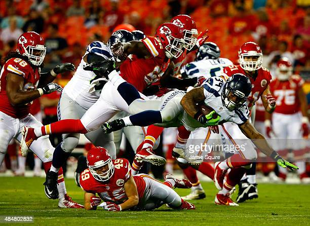 Running back Thomas Rawls of the Seattle Seahawks lunges for a first down during the preaseason game against the Kansas City Chiefs at Arrowhead...