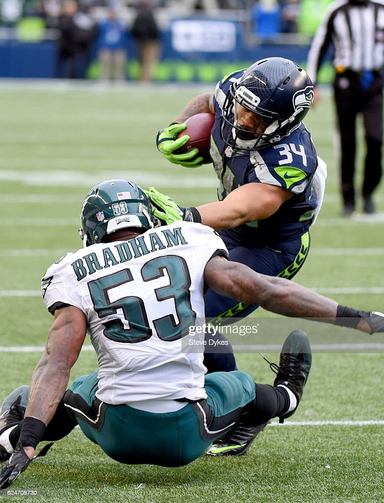 Running back Thomas Rawls #34 of the Seattle Seahawks rushes against linebacker Nigel Bradham #53 the Philadelphia Eagles at CenturyLink Field on November 20, 2016 in Seattle, Washington.