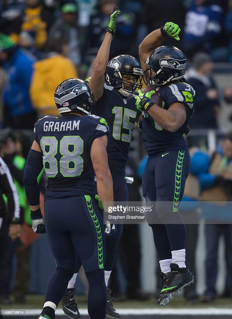 Running back Thomas Rawls #34, right, of the Seattle Seahawks celebrates scoring a touchdown with wide receiver Jermaine Kearse #15 of the Seattle Seahawks and tight end Jimmy Graham #88 of the Seattle Seahawks during the second half of a football game against the Pittsburgh Steelers at CenturyLink Field on November 29, 2015 in Seattle, Washington. The Seahawks won the game 39-30.