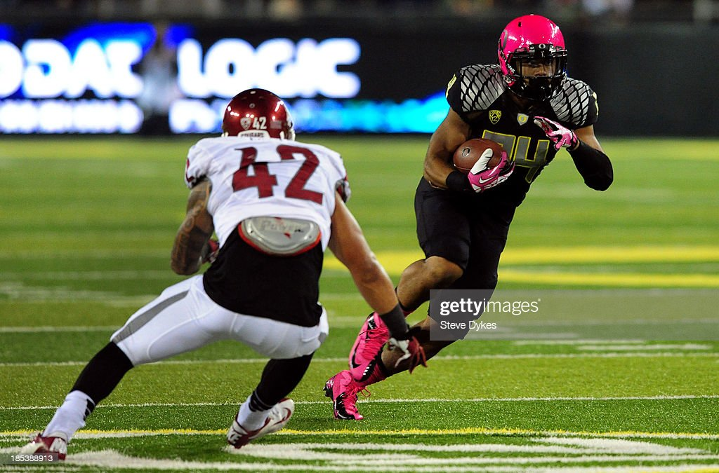 Running back Thomas Tyner #24 of the Oregon Ducks avoids the tackle of linebacker Cyrus Coen #42 of the Washington State Cougars during the third quarter of the game at Autzen Stadium on October 19, 2013 in Eugene, Oregon. Oregon won the game 62-38.