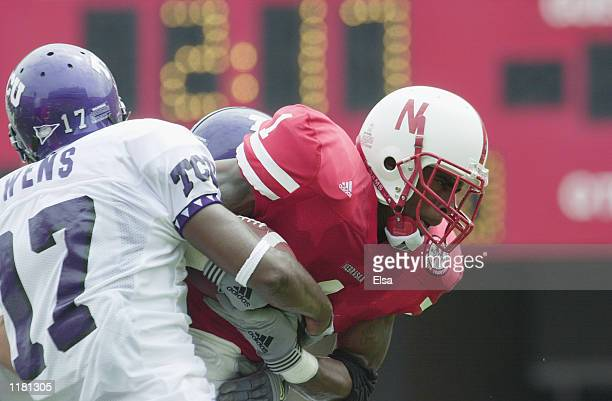 Running back Thunder Collins of the Nebraska Cornhuskers protects the ball from safety Charlie Owens of the Texas Christian University Horned Frogs...