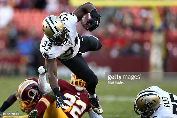 Running back Tim Hightower of the New Orleans Saints carries the ball past cornerback Deshazor Everett of the Washington Redskins in the fourth...