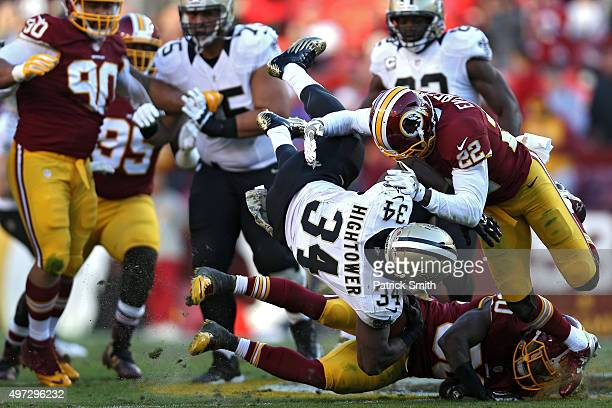 Running back Tim Hightower of the New Orleans Saints is tackled by cornerback Deshazor Everett of the Washington Redskins in the fourth quarter at...