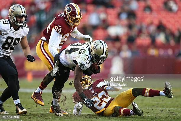 Running back Tim Hightower of the New Orleans Saints rushes against cornerback Deshazor Everett of the Washington Redskins in the fourth quarter at...
