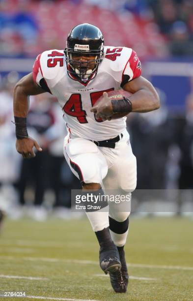 Running back T.J. Duckett of the Atlanta Falcons carries the ball against the New York Giants during the game at Giant Stadium on November 9, 2003 in...