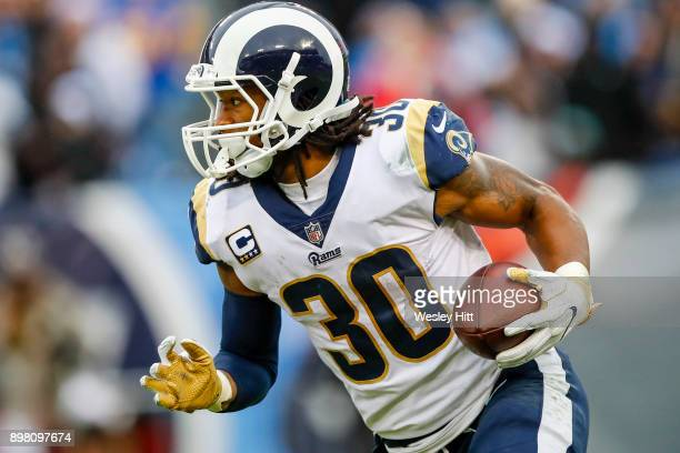 Running Back Todd Gurley II of the Los Angeles Rams carries the ball against the Tennessee Titians at Nissan Stadium on December 24 2017 in Nashville...