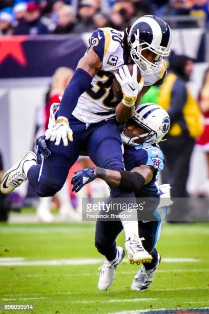 Running Back Todd Gurley II of the Los Angeles Rams carries the ball against Corner Back Tye Smith of the Tennessee Titans at Nissan Stadium on...
