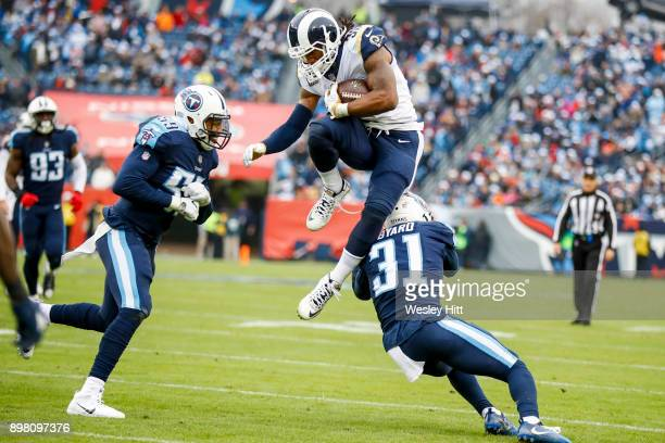Running Back Todd Gurley II of the Los Angeles Rams jumps over Safety Kevin Byard of the Tennessee Titans at Nissan Stadium on December 24 2017 in...