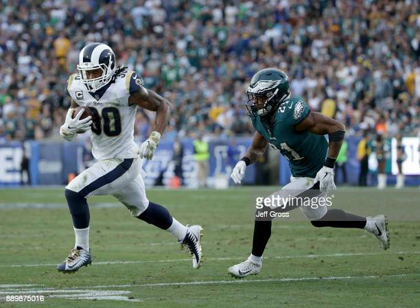 Running back Todd Gurley of the Los Angeles Rams carries the ball while being pursued by cornerback Patrick Robinson of the Philadelphia Eagles in...