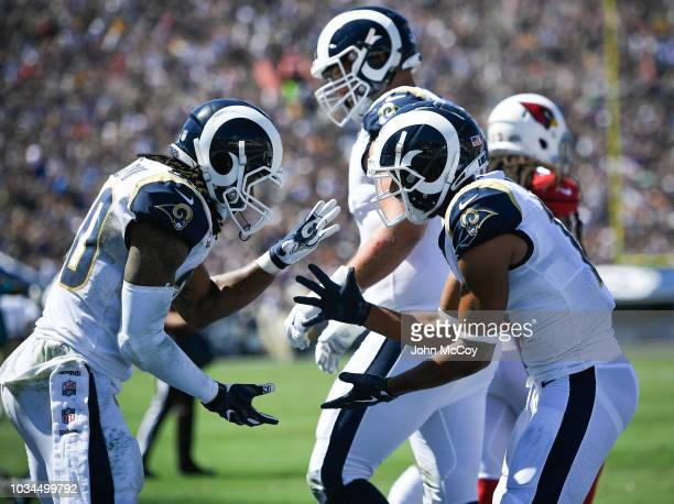 Running back Todd Gurley of the Los Angeles Rams celebrates with wide receiver Robert Woods after his touchdown in the second quarter against the...