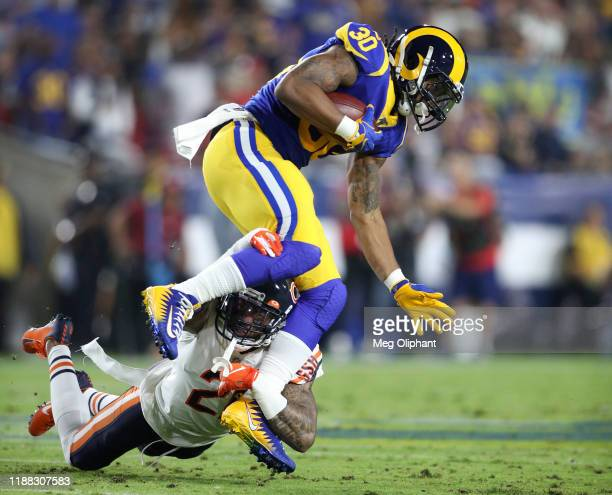 Running back Todd Gurley of the Los Angeles Rams is tackled by strong safety Ha Ha Clinton-Dix of the Chicago Bears in the first quarter at Los...