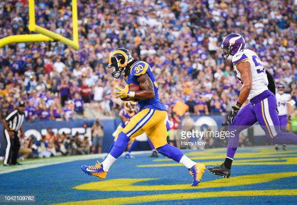 Running back Todd Gurley of the Los Angeles Rams makes a catch for a touchdown to tie the game 7-7 in the first quarter against the Minnesota Vikings...