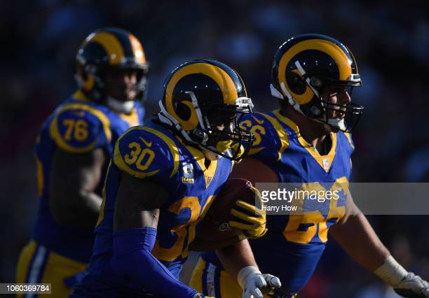 Running back Todd Gurley of the Los Angeles Rams runs after his catch in the third quarter against the Seattle Seahawks at Los Angeles Memorial...