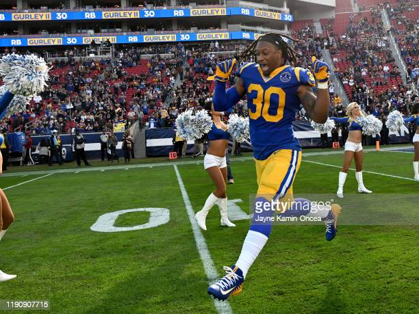Running back Todd Gurley of the Los Angeles Rams runs on to the field for the game against the Arizona Cardinals at the Los Angeles Memorial Coliseum...