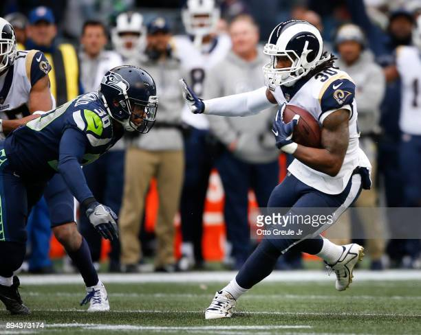 Running back Todd Gurley of the Los Angeles Rams rushes against free safety Bradley McDougald of the Seattle Seahawks as he rushes during the first...