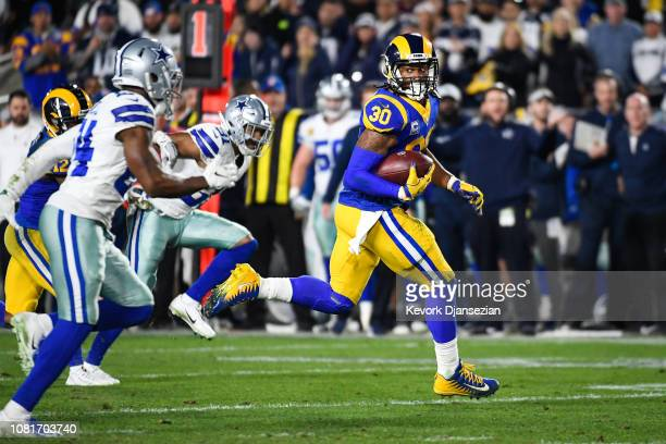 Running back Todd Gurley of the Los Angeles Rams rushes for a touchdown in the second quarter against the Dallas Cowboys to take a 20-7 in the NFC...