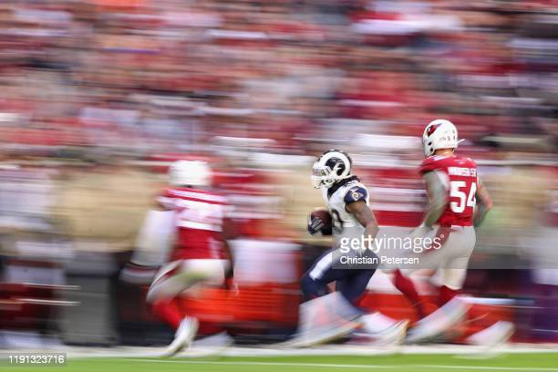 Running back Todd Gurley of the Los Angeles Rams rushes the football past linebacker The Rans defeated Cardinals 34-7. #54 of the Arizona Cardinals...