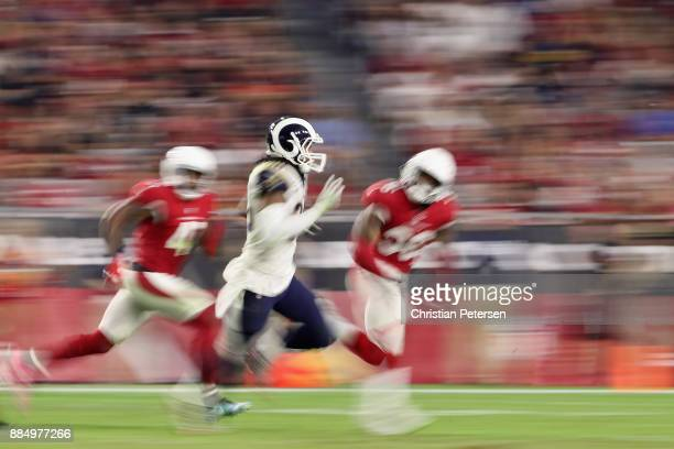 Running back Todd Gurley of the Los Angeles Rams rushes the football against safety Budda Baker of the Arizona Cardinals during the NFL game at the...