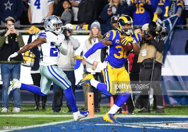 Running back Todd Gurley of the Los Angeles Rams scores a touchdown in the second quarter against the Dallas Cowboys for a 207 lead in the NFC...