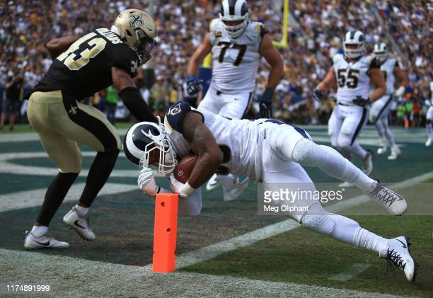 Running back Todd Gurley of the Los Angeles Rams scores a touchdown in the third quarter against the New Orleans Saints at Los Angeles Memorial...