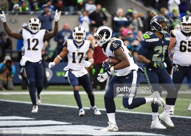 Running back Todd Gurley of the Los Angeles Rams scores another 1 yard touchdown against the Seattle Seahawks during the game at CenturyLink Field on...