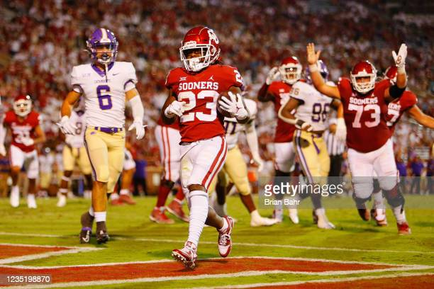 Running back Todd Hudson of the Oklahoma Sooners scores a touchdown on a six-yard run against defensive back Nick Oelrich and the Western Carolina...