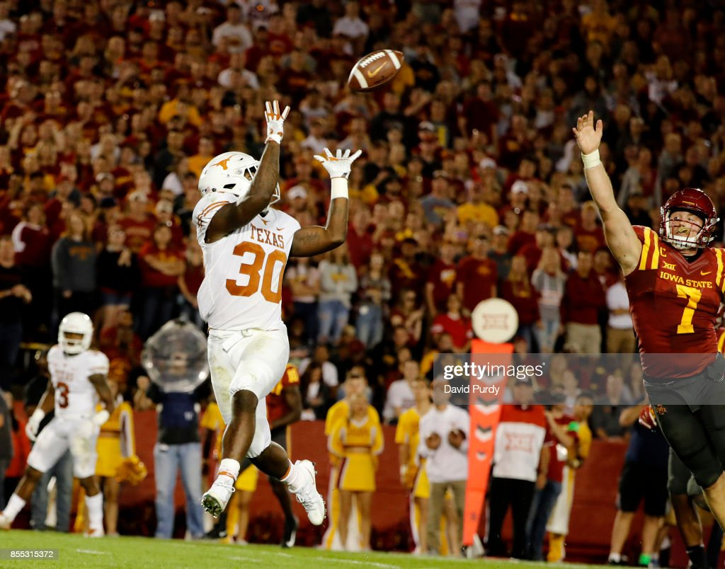 Running back Toneil Carter #30 of the Texas Longhorns pulls in a touchdown pass over linebacker Joel Lanning #7 of the Iowa State Cyclones in the first half of play at Jack Trice Stadium on September 28, 2017 in Ames, Iowa.