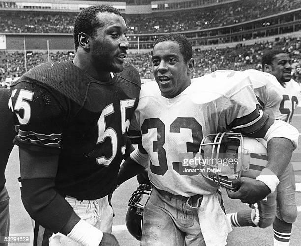 Running back Tony Dorsett of the Dallas Cowboys congratulates linebacker Otis Wilson of the Chicago Bears after the Bears 440 rout over the Cowboys...