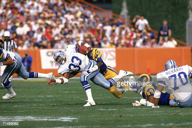 Running back Tony Dorsett of the Dallas Cowboys gets tackled by defensive back Johnnie Johnson of the Los Angeles Rams during a 1985 NFC Divisional...