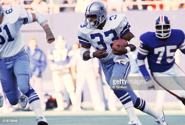 Running back Tony Dorsett of the Dallas Cowboys rushes for yards during a game against the New York Giants at Giants Stadium on November of 1979 in...