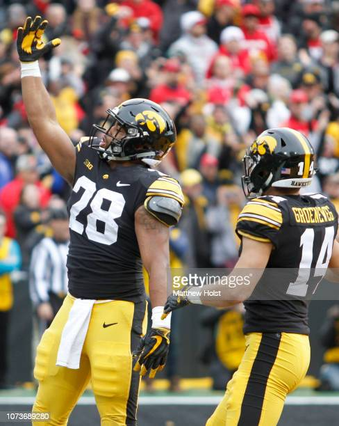 Running back Toren Young of the Iowa Hawkeyes celebrates a touchdown during the first half against the Nebraska Cornhuskers on November 23 2018 at...