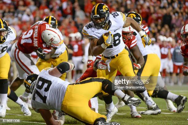 Running back Toren Young of the Iowa Hawkeyes runs against the Nebraska Cornhuskers at Memorial Stadium on November 24 2017 in Lincoln Nebraska